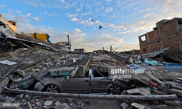TOPSHOT Picture showing the destruction in Manta Ecuador on April 17 2016 a day after a powerful 78magnitude quake hit the country The toll from the...