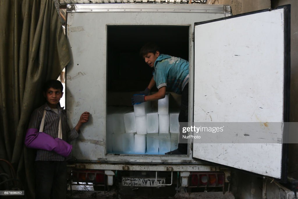 A picture showing the mobile car where the ice cubes are placed for distribution to the centers in Douma of Damascus, Syria, on 19 June 2017.