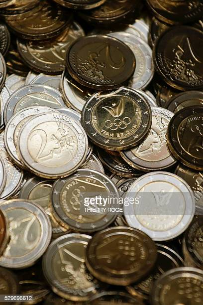 A picture shows 2 euro coins displayed during the presentation of Belgium's olympicthemed coin ahead of the 2016 Rio de Janeiro Olympic Games at the...
