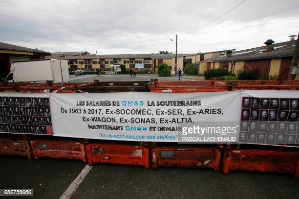 A picture shows a banner at the plant of automotive supplier GMS Industry where around 280 jobs are on the line in La Souterraine central France on...
