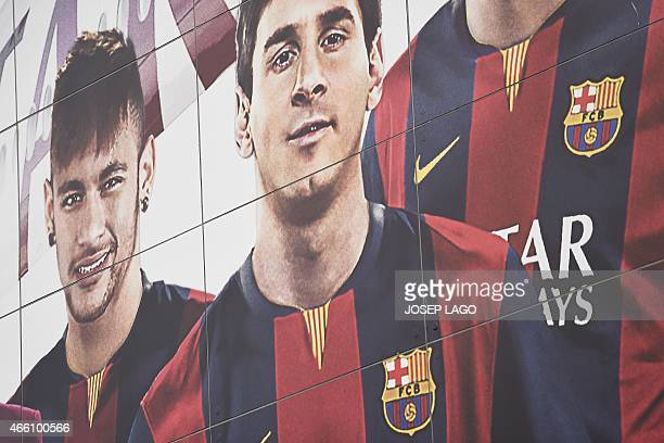 Picture shows a billboard displaying FC Barcelona's players Argentinian forward Lionel Messi and Brazilian forward Neymar da Silva Santos Junior...