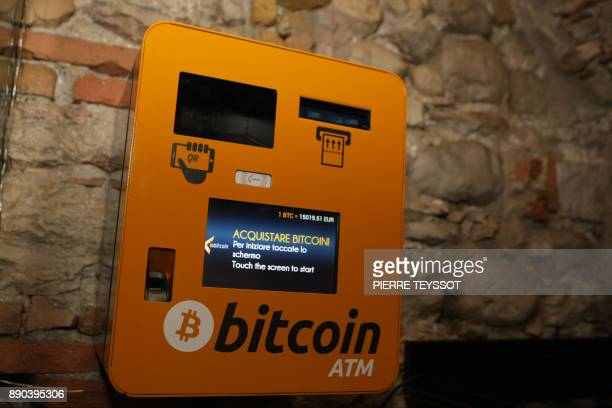 A picture shows a Bitcoin ATM on December 11 2017 in Rovereto northern Italy Bitcoin surged past $18000 after making its debut on a major global...