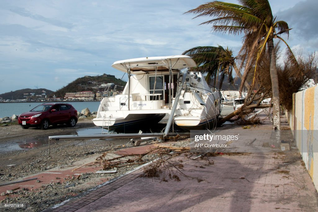 A picture shows a boat on the land on September 14, 2017 in Marigot on the French Caribbean island of Saint Martin, after the island was hit by Hurricane Irma. The Category 4 hurricane, which struck in 1995, killed 19 people in St Martin, Antigua, Barbuda, St Barts and Anguilla and left tens of thousands homeless. Irma left 15 dead on both sides of St Martin. PHOTO / Helene Valenzuela