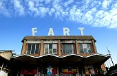 A picture shows a building with giant letters on the rooftop composing the word 'Fart' at the Metropoliz Museum of the Other and the Elsewhere which...