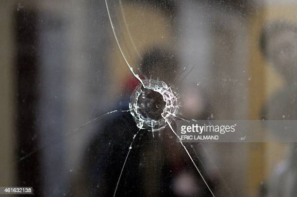 A picture shows a bullet hole in a window on the site where two suspected jihadists were killed in an antiterrorist operation in Verviers eastern...