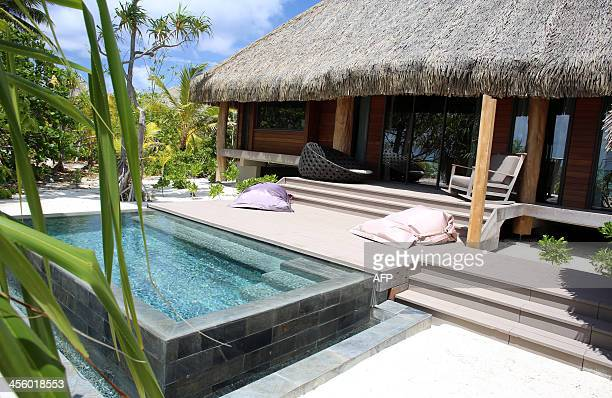 A picture shows a bungalow at The Brando an ecofriendly resort on the private island of Tetiaroa on December 10 2013 After two years of construction...