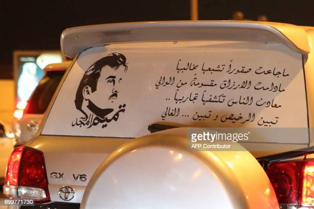 A picture shows a car sticker portraying Qatar's Emir Sheikh Tamim bin Hamad AlThani outside the capital Doha on June 11 2017 The diplomatic crisis...