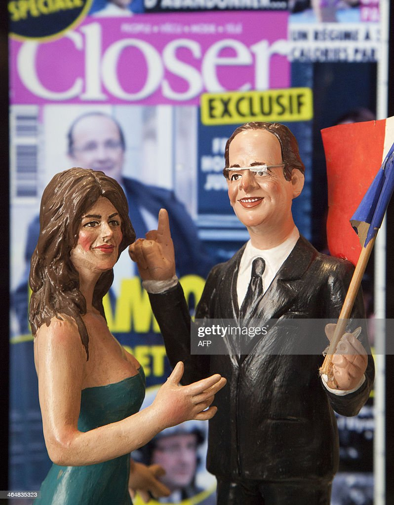 A picture shows a Christmas figurine representing French President Francois Hollande and actress Julie Gayet on January 24, 2013 in Genny Di Virgilio's shop in San Gregorio Armeno street in Naples, a narrow street often called the street of nativity workshops or Christmas Alley.