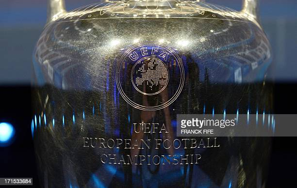 A picture shows a close up detail of the Coupe Henri Delaunay the trophy of the UEFA European Football Championship displayed at a press conference...