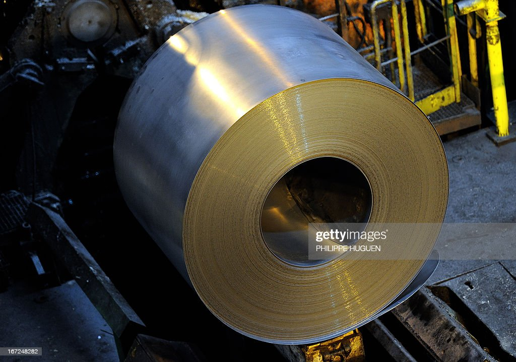 A picture shows a coil of steel at the blast furnace of the ArcelorMittal steel plant of Grande-Synthe, northern France, on April 22, 2013.