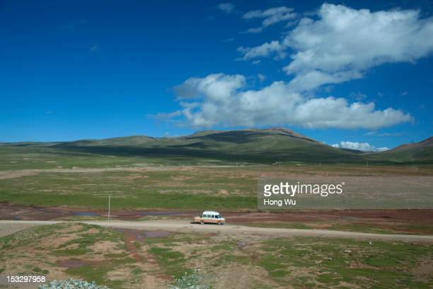 Picture shows a construction vehicle runs on the road taken in a train carriage of from Beijing to Lhasa on August 15 2012 in Amdo China After...