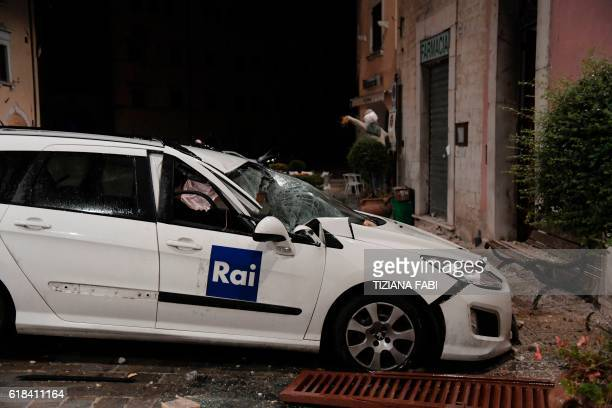 A picture shows a damaged car in the village of Visso central Italy following earthquakes on October 26 2016 Twin earthquakes rocked central Italy on...