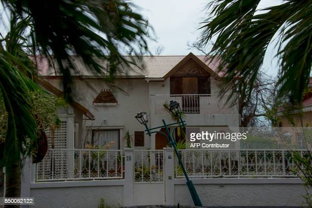 A picture shows a damaged lamp post on September 20 on the French side of the Caribbean island of SaintMartin after hurricane Maria and Hurricane...