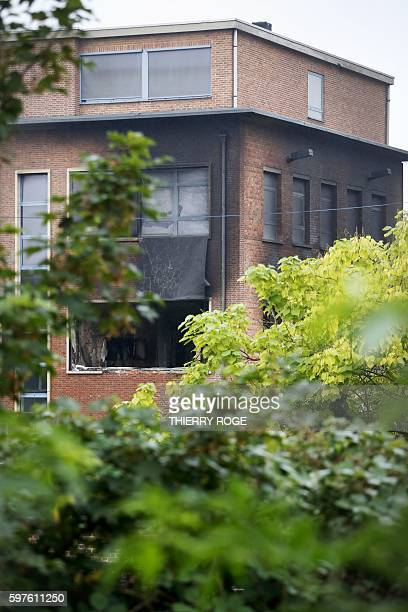 A picture shows a damaged window of the National Institute for Criminalistics and Criminology after an explosion overnight on August 29 2016 in...