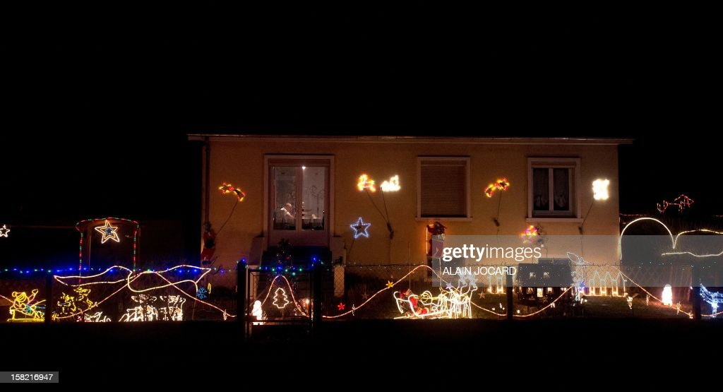 A picture shows a decorated home for Christmas on december 11, 2012 in Blere, near Tour, central France.