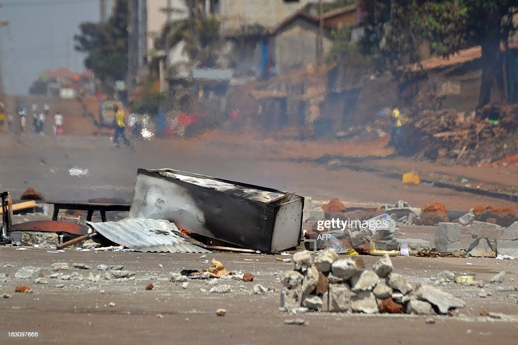 A picture shows a destroyed barricade on March 4, 2013 in Conakry. Guinea's President Alpha Conde on Monday met with political representatives and campaigners to try to resolve a conflict that last week led to the death of at least six people. Violence broke out in the Guinean capital Conakry last week as the opposition staged a demonstration calling for transparency during the May 12 legislative polls and to protest against the South African company selected to revise the electoral roll. AFP PHOTO / CELLOU BINANI