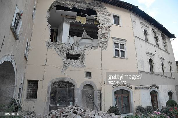 TOPSHOT A picture shows a destroyed building in the village of Visso central Italy on October 27 2016 Twin earthquakes rocked central Italy on...