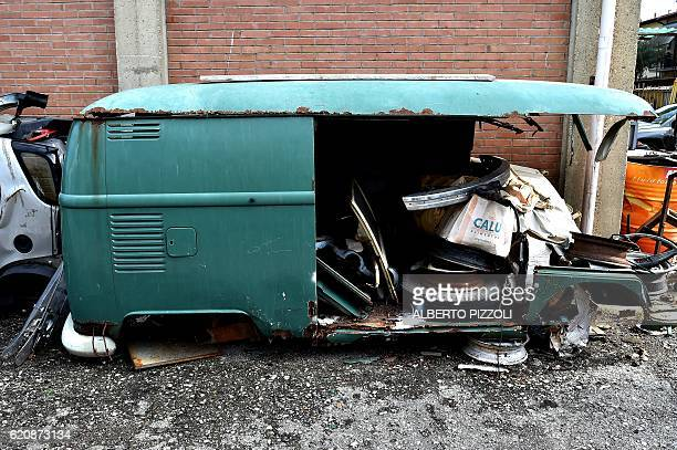 A picture shows a destroyed van in the garage Nucci where the 'T1 specialist' team restore vintage Volkswagen Kombi bus on November 3 2016 in...