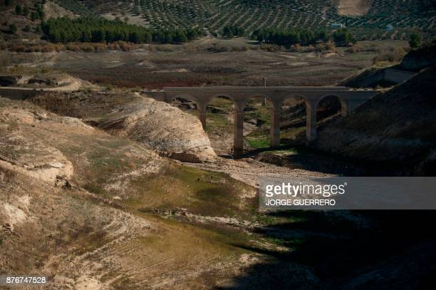 A picture shows a droughtstricken dried up part of the Iznajar reservoir near Cordoba on November 20 2017 Spain and Portugal are grappling with a...