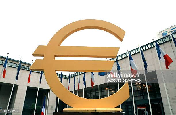 A picture shows a Euro currency symbol as part of a lifesize Game of the Goose set up in the courtyard of the Economy and Finance Ministry in Paris...