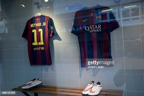 Picture shows a football jersey with the name of Barcelona's Brazilian forward Neymar da Silva Santos Junior at the FC Barcelona's store at the Camp...