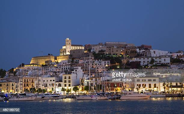 Picture shows a general view of Dalt Vila and the port of the city of Ibiza on July 9 2015 AFP PHOTO / JAIME REINA