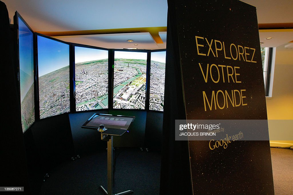 A picture shows a Google Earth stand at the Google France new offices on December 6, 2011 in Paris.