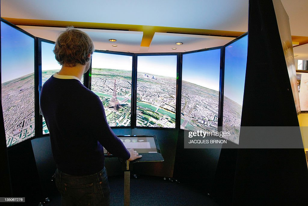 A picture shows a Google Earth stand at the Google France new offices on December 6, 2011 in Paris. AFP PHOTO POOL JACQUES BRINON
