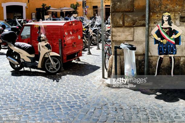 A picture shows a graffii depicting the Rome's mayor Virginia Raggi as 'Wonder Virginia' on August 15 2017 in central Rome / AFP PHOTO / Alberto...