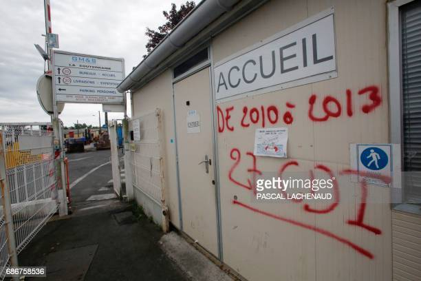 A picture shows a graffito reading 'From 2010 to 2013 27 CDI' at the entrance of the plant of automotive supplier GMS Industry where around 280 jobs...