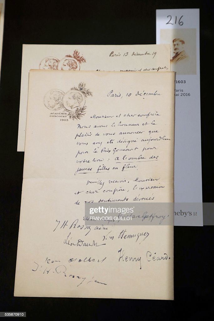 A picture shows a letter from the Goncourt Academy written in 1919 to French writer Marcel Proust to announce he is awarded the French literary prize 'Prix Goncourt' for his novel 'A l'ombre des jeunes filles en fleurs' (Within a Budding Grove) during the presentation of Proust;s personal archives ahead of an auction at Sotheby's in Paris, on May 30, 2016. / AFP / FRANCOIS
