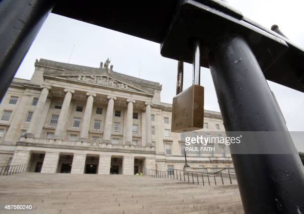 A picture shows a locked gate in front of the Stormont Parliament Buildings the seat of the Northern Ireland Assembly in Belfast Northern Ireland on...