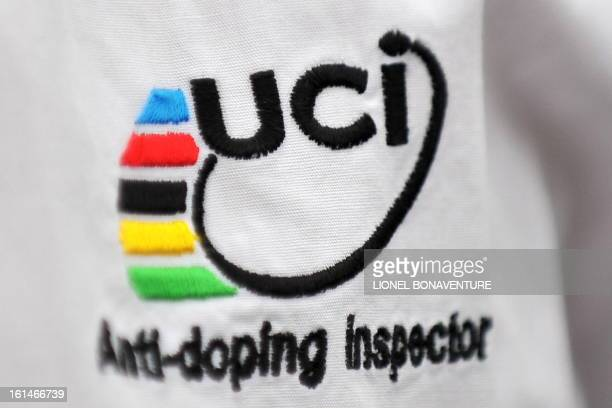 Picture shows a logo of the International cycling Union displayed on the shirt of an antidoping inspector on July 14 2009 at the end of the 193 km...