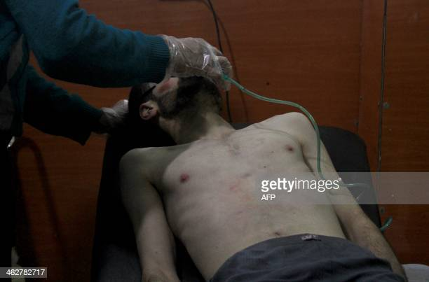 A picture shows a man being treated at a field hospital after an alleged poison gas attack by troops loyal to President Bashar alAssad in the...