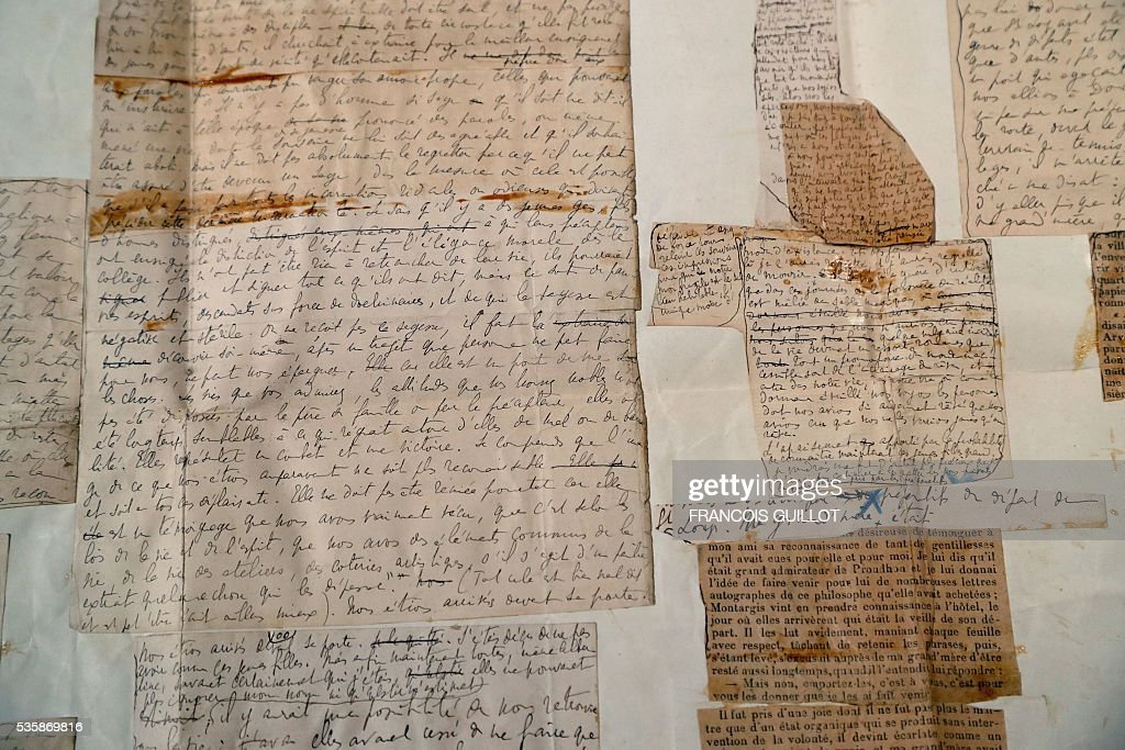 A picture shows a manuscript of the novel 'A l'ombre des jeunes filles en fleurs' (Within a Budding Grove) from 1914-1919 during the presentation of personal archives of French writer Marcel Proust, ahead of an auction at Sotheby's in Paris, on May 30, 2016. / AFP / FRANCOIS