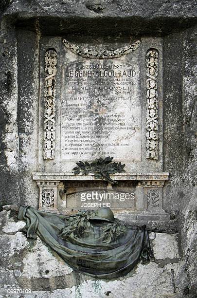 A picture shows a memorial monument carved on rocks marking the entry of French troops into Damascus in 1920 in the Nahr alKalb area north of the...