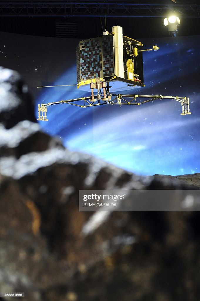 A picture shows a model of the European Space Agency's robot craft Philae at the the Cite de l'espace in Toulouse southern France on November 12 the...