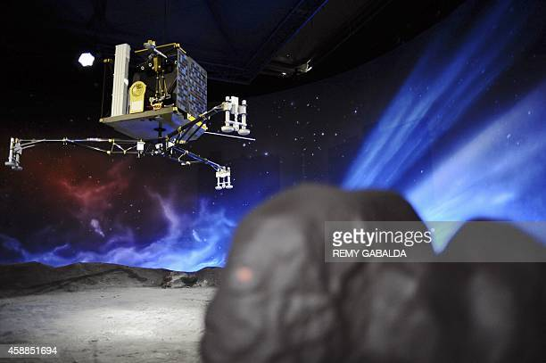 A picture shows a model of the European Space Agency's robot craft Philae at the Cite de l'espace in Toulouse southern France on November 12 the day...
