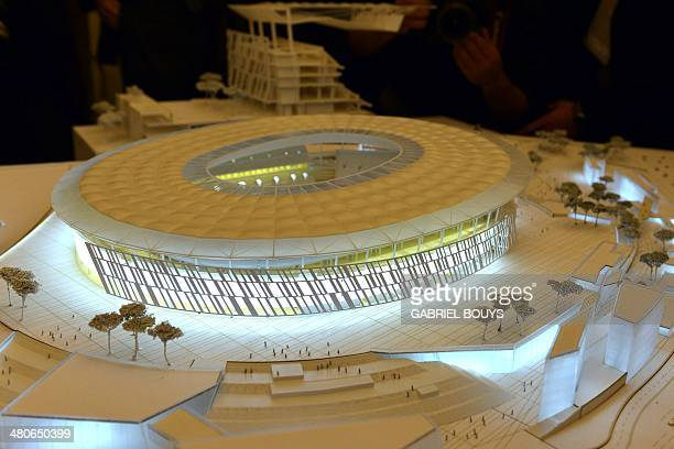 A picture shows a model of the Rome's new stadium project designed by US architect Dan Meis during a press conference on March 26 2014 in Rome AS...