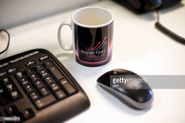 A picture shows a mug on a desk at the headquarters of Superfast Cornwall funded by the European Union's biggest single investment in high speed...