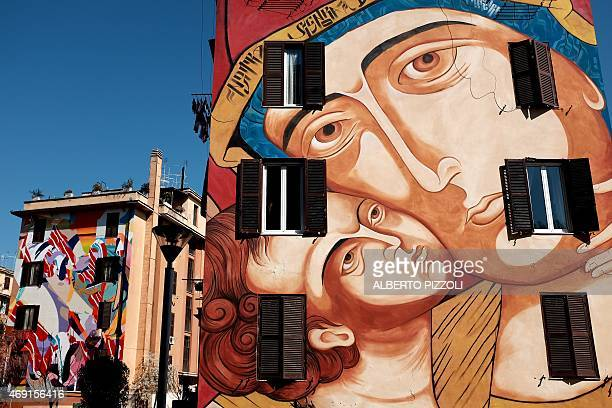 A picture shows a mural entitled 'Santa Maria di Shangai' by Italian artist MR Klevra on April 9 2015 in the Tor Marancia district of Rome The mural...