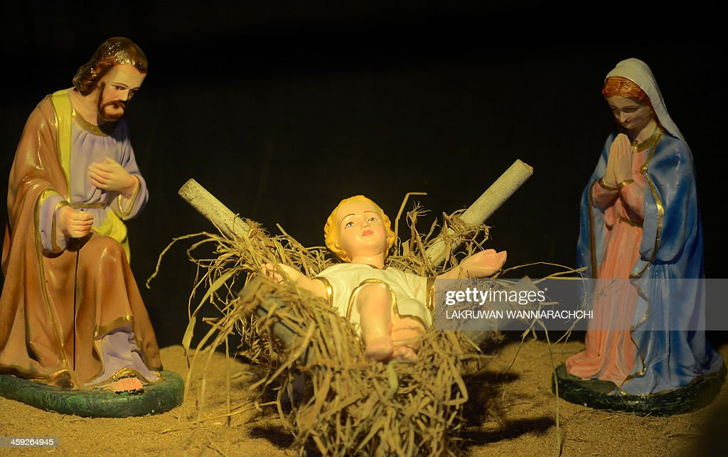 A picture shows a nativity scene in Colombo in the early hours of Christmas day on December 25, 2013.