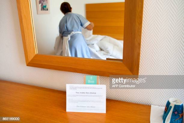 A picture shows a notice asking clients whether they want linens to be changed at a five stars hotel in the resort town of Ayia Napa in southeastern...