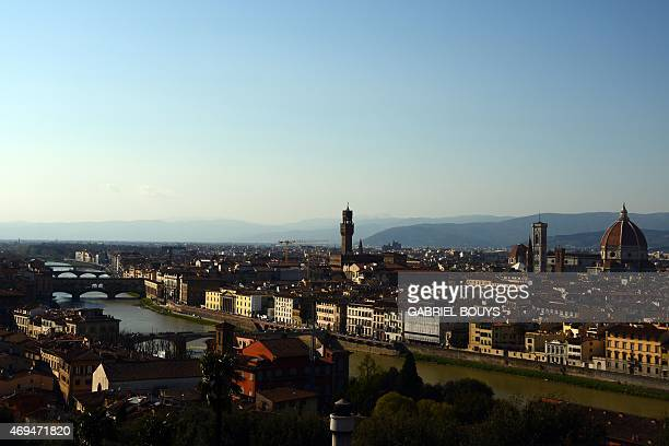 A picture shows a panorama of the city of Florence with the 'Duomo' the Santa Maria del Fiore cathedral the tower of the Palazzo Vecchio Florence's...