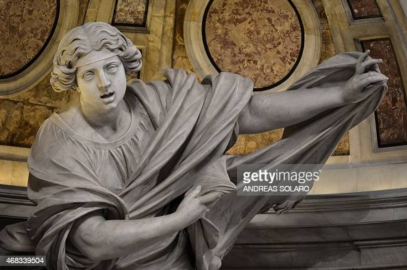 A picture shows a part of the statue 'Santa Veronica and the Veil' at St Peter's basilica during a Chrism mass for Holy Thursday which marks the...
