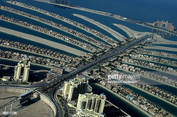 A picture shows a partial aerial view of the manmade Palm Jumeirah island built by Nakheel property giant off the coast of the Gulf emirate of Dubai...