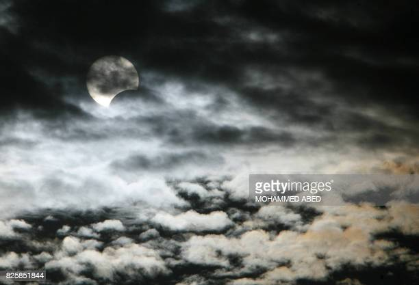 A picture shows a partial solar eclipse over Gaza City of on January 15 2010 An annular eclipse raced across central and eastern Africa on January 15...