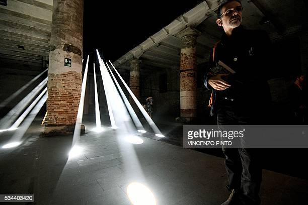 A picture shows a perforated roof shelter to make 'rain of light' designed by architect studio 'Transsolar' on May 25 2016 during the opening of the...