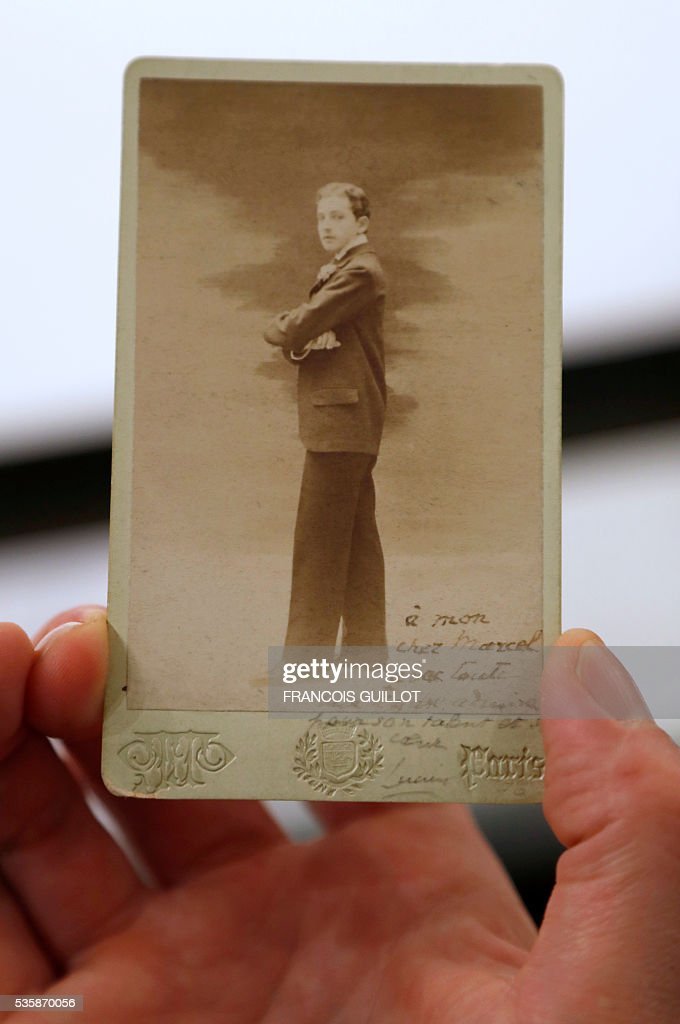 A picture shows a photograph of French writer Lucien Daudet in 1896 during the presentation of personal archives of French writer Marcel Proust, ahead of an auction at Sotheby's in Paris, on May 30, 2016. / AFP / FRANCOIS