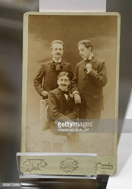A picture shows a photograph of French writer Marcel Proust French playwright and journalist Robert de Flers and French writer Lucien Daudet during...